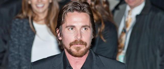 Actor Christian Bale leaving the press conference for the movie American Hustle