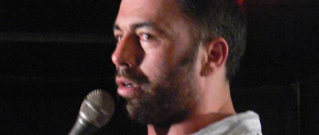 Joe Rogan on stage doing stand-up.