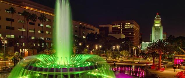 Grand Park at night, with the illuminated Arthur J. Will Memorial Fountain, LA city hall.